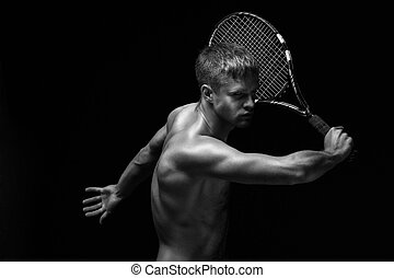 Male tennis player - A man playing tennis with his shirt off