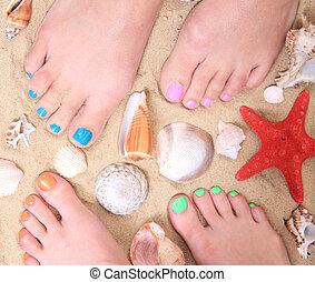 nice legs with pedicure in the beach sand