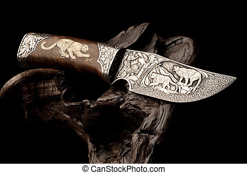 Ornamental hunting knife. - Details of elaborate wildlife...