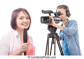 young woman journalist with a microphone and camerawoman