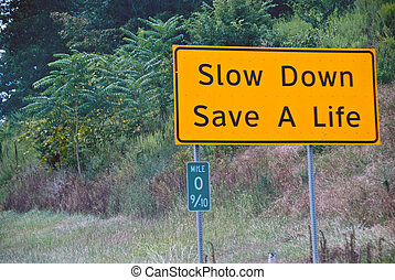 Slow Down, Save a Life - Street Sign on a American Road,...