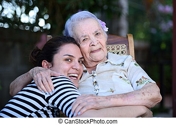 Grandma and grandaughter smiling - grandma and grandaughter...
