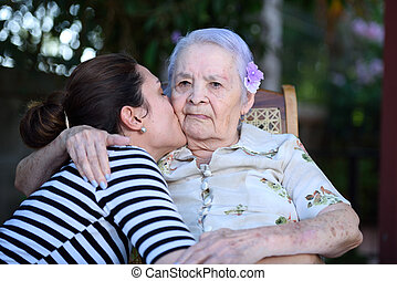 Grandaughter kissing grandma - Grandaughter happy kissing...