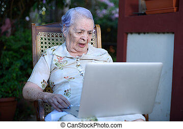 Grandma on a videocall - grandma on a videocall using a...