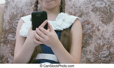 Little girl making selfie using a smartphone