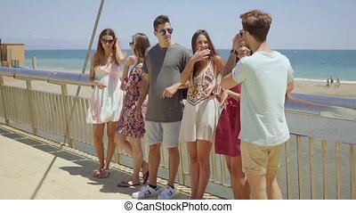 Group of teens hanging out near beach - Group of male and...