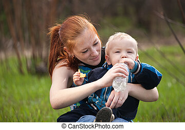 mother with son drinking water