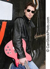 rock star man black graffiti holding electric guitar