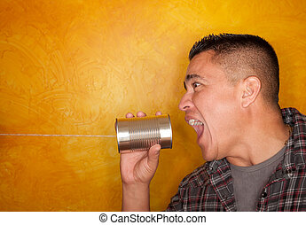 Hispanic man with tin can telephone - Attractive Hispanic...