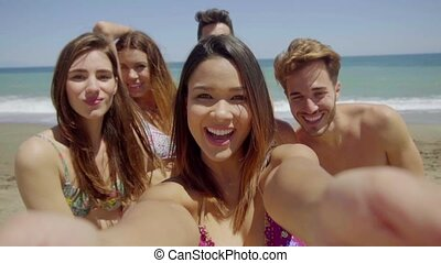 Group of Friends Taking Selfie on Sunny Beach - Head and...