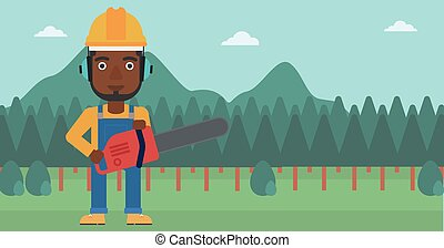 Lumberjack with chainsaw - An african-american man holding a...
