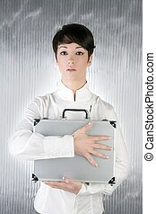 androgynous woman holding silver briefcase - androgynous...