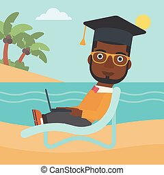 Graduate lying on chaise lounge with laptop - An...