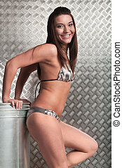 One sexy girl in lingerie standing in stainless metal...