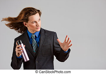Hairstylist with spray can - Male stylist with spray can and...