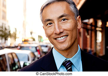 Business Man Portrait - A portrait of a happy asian looking...