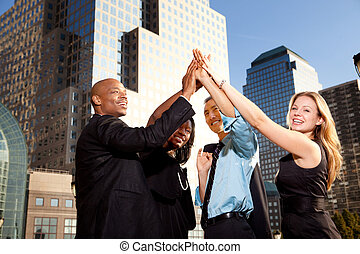 Business Achievement - A group of business people happy and...