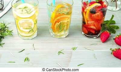 Detox water cocktails on wooden table