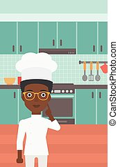 Chef pointing forefinger up - An african-american cheerful...