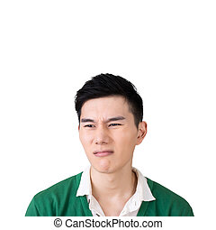 Funny facial expression, closeup Asian young man