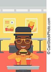 Man eating hamburger.