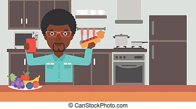 Man with fast food. - An african-american man holding a...