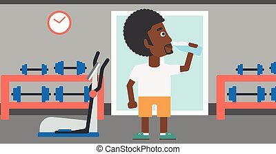 Man drinking water. - An african-american man drinking water...