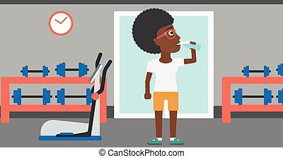 Woman drinking water. - An african-american woman drinking...