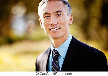 Business Portrait - A portrait of a friendly Asian looking...