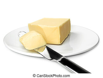 Piece of fresh butter on a white plate. Isolated on white.