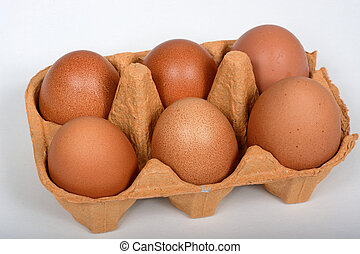 Six organic eggs in a carton. - Six fresh brown eggs in a...
