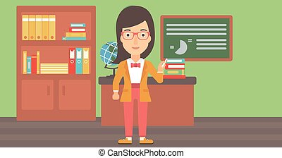 Woman with chalk in hand. - A woman standing in classroom in...