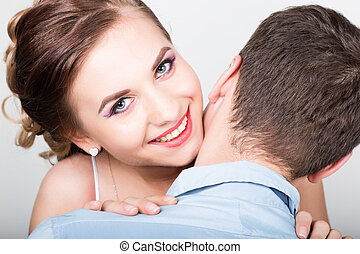 couple in love, woman gently touches  tongue to his neck