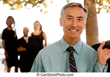 Asian Business Man - An asian looking business man with...