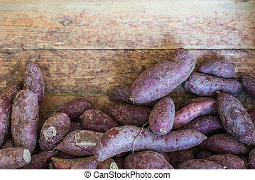 The pile of japanese purple potato as background