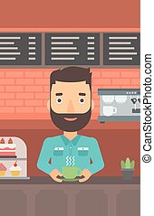 Man making coffee - A hipster man with the beard standing at...