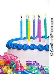Birthday cake and streamers isolated against white