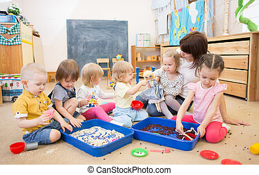 Children with teacher improving hands motor skills in...