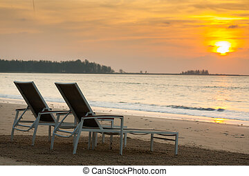 beach chairs before sunset - two beach chairs before sunset...