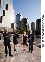 Big City Business Team - A business team portrait with large...