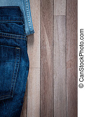 jeans on a grunge wooden background