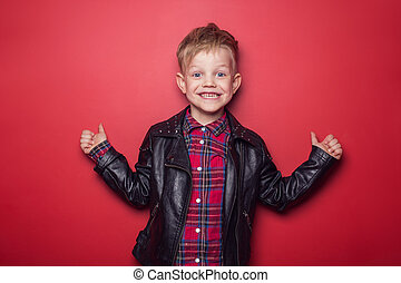 child in leather jacket - Fashion little boy wearing a...