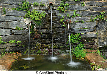Stone fountain - stone fountain with three jets of water...