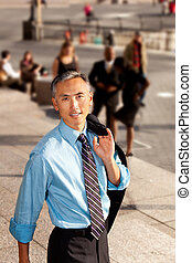 Casual Business Man - A casual candid portrait of an Asian...