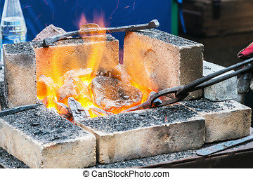 forge a burning forge and tools. focus on the coals and...