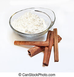 Powdered sugar and cinnamon on a white background