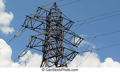 High-voltage power line on sky background, taymlapse -...