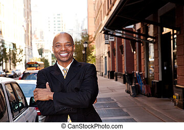 Happy Business Man - A happy business man on a street in a...