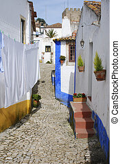 Alley in Portuguese village - Laundry hanging in narrow...