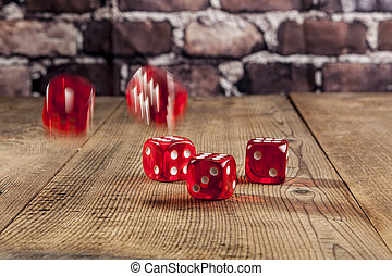 Red Dice on Table - Falling red dice on brown wood table